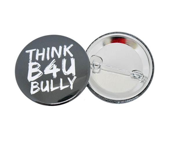 Message on a 38mm button badge with a safety pin