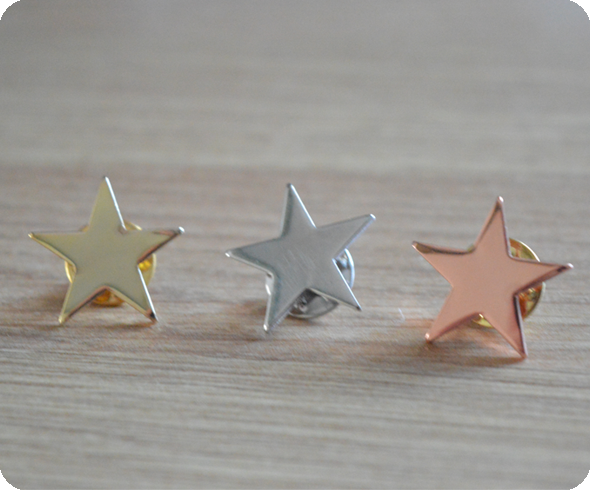 Gold, silver and bronze star badges